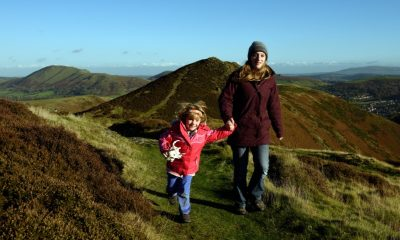 Mum and daughter walking on The Long Mynd, near Carding Mill Valley