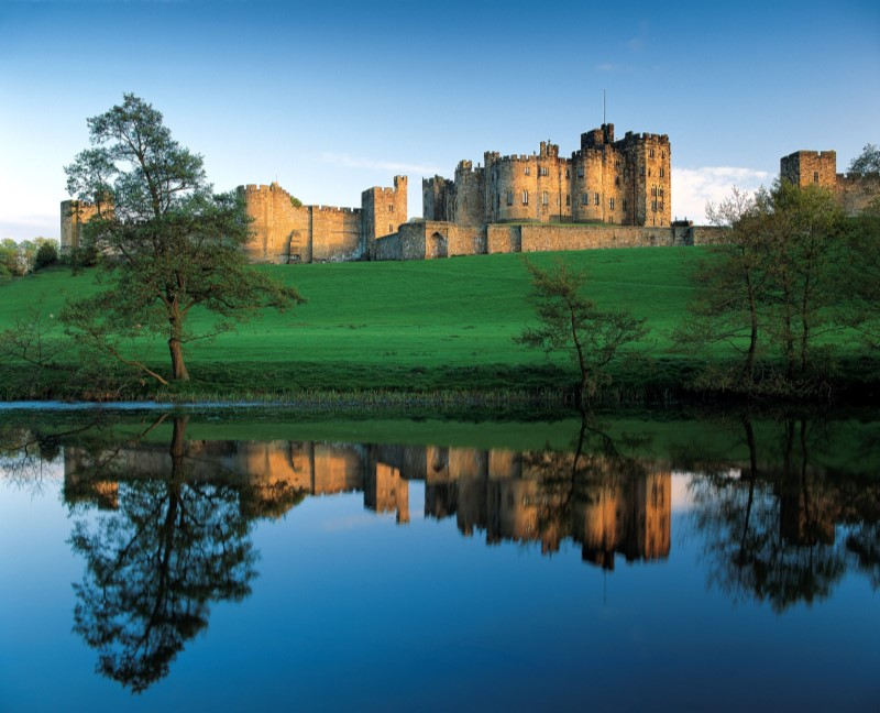 Alnwick Castle reflected in a lake