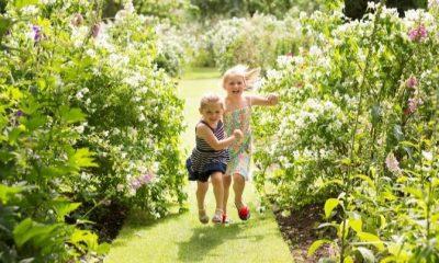 Young girls running through gardens at Castle Howard