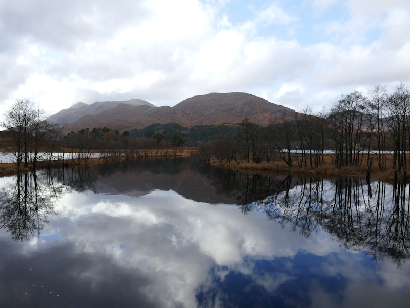 Hill reflected in lake - Fort William car-free adventures