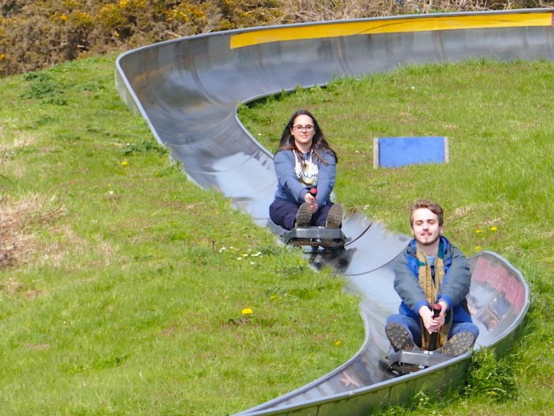 Two people on dry toboggans - Carmarthen car-free