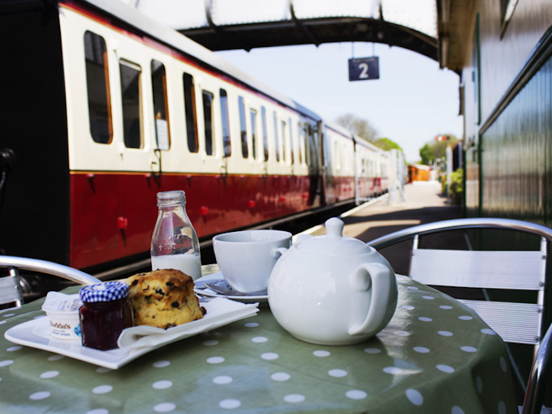 Tea and cakes next to a train - eaten on our tour of tea and cakes car-free venues